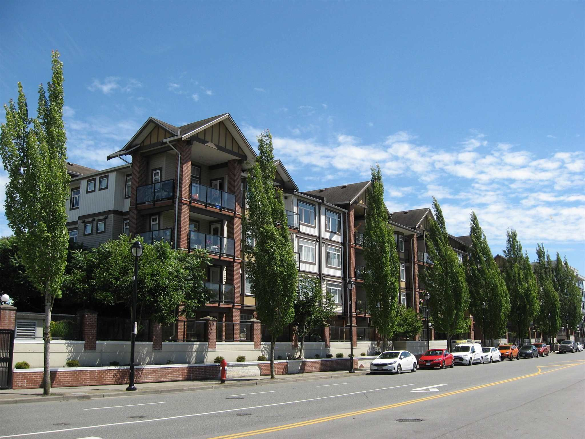 """Main Photo: 430 5660 201A Street in Langley: Langley City Condo for sale in """"Paddington Station"""" : MLS®# R2596391"""