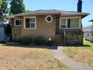 Photo 1: 1028 E 56TH Avenue in Vancouver: South Vancouver House for sale (Vancouver East)  : MLS®# R2478480