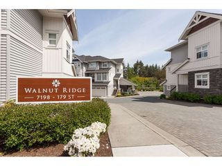 "Photo 1: 11 7198 179 Street in Surrey: Cloverdale BC Townhouse for sale in ""WALNUTRIDGE"" (Cloverdale)  : MLS®# R2366816"
