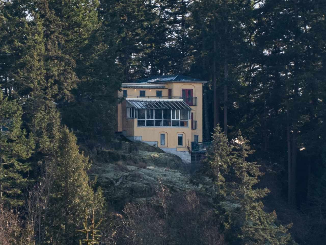 Impressive home perched atop a rocky outcropping
