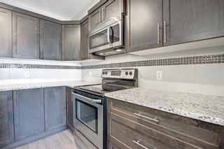 Photo 5: 555 Redstone View NE in Calgary: Redstone Row/Townhouse for sale : MLS®# A1149779