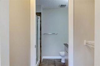 Photo 23: 102 501 RIVER HEIGHTS Drive: Cochrane Row/Townhouse for sale : MLS®# C4266118