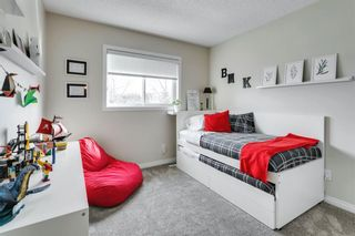 Photo 30: 84 Coach Side Terrace SW in Calgary: Coach Hill Semi Detached for sale : MLS®# A1077504