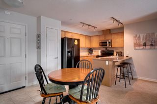 Photo 8: 1302 92 Crystal Shores Road: Okotoks Apartment for sale : MLS®# A1132113