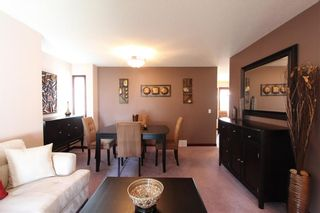 Photo 6: 218 ARBOUR RIDGE Park NW in Calgary: Arbour Lake House for sale : MLS®# C4186879
