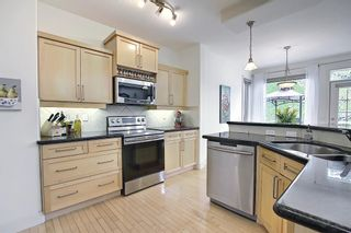 Photo 22: 12 Strathlea Place SW in Calgary: Strathcona Park Detached for sale : MLS®# A1114474