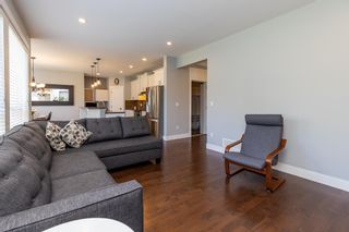 """Photo 4: 7021 195A Street in Surrey: Clayton House for sale in """"Clayton"""" (Cloverdale)  : MLS®# R2594485"""