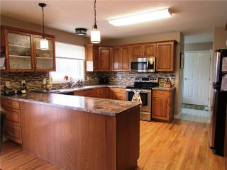 """Photo 2: 12148 WEST BY PASS Road in Fort St. John: Fort St. John - Rural W 100th House for sale in """"FISH CREEK"""" (Fort St. John (Zone 60))  : MLS®# N233953"""