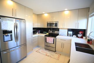 Photo 11: 104 1530 Bayside Avenue SW: Airdrie Row/Townhouse for sale : MLS®# A1147383