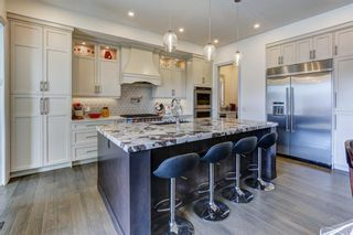 Photo 9: 907 31 Avenue NW in Calgary: Cambrian Heights Detached for sale : MLS®# A1095749