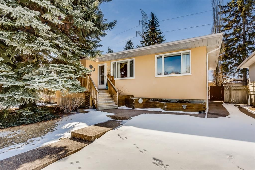 Main Photo: 411 49 Avenue SW in Calgary: Elboya Detached for sale : MLS®# A1061526