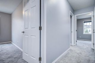 Photo 29: 129 Windstone Park SW: Airdrie Row/Townhouse for sale : MLS®# A1137155