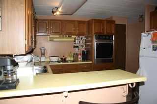 Photo 4: 264 Spring Haven Court SE: Airdrie Detached for sale : MLS®# A1084823