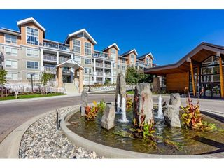 "Photo 2: 415 6490 194 Street in Surrey: Clayton Condo for sale in ""Waterstone"" (Cloverdale)  : MLS®# R2411705"