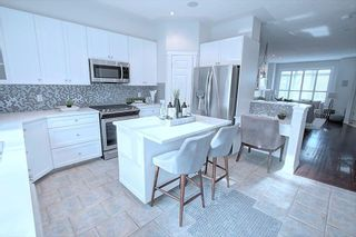 Photo 6: 314 GARRISON Square SW in Calgary: Garrison Woods Row/Townhouse for sale : MLS®# A1127756