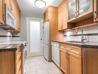 """Photo 8: 215 555 W 14TH Avenue in Vancouver: Fairview VW Condo for sale in """"Cambridge Place"""" (Vancouver West)  : MLS®# R2470013"""