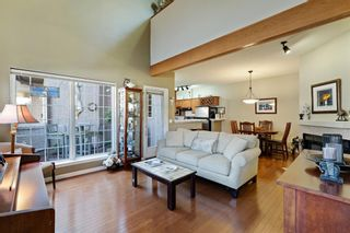 Photo 2: 101 1997 Sirocco Drive SW in Calgary: Signal Hill Row/Townhouse for sale : MLS®# A1142333