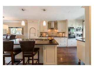 """Photo 1: 4687 HOSKINS Road in North Vancouver: Lynn Valley Townhouse for sale in """"Yorkwood Hills"""" : MLS®# V1130189"""
