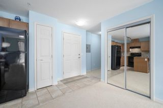 Photo 4: 3215 92 Crystal Shores Road: Okotoks Apartment for sale : MLS®# A1103721