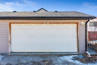 Photo 25: 702 69 Avenue SW in Calgary: Kingsland Semi Detached for sale : MLS®# A1081661