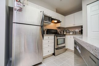 "Photo 6: 402 20277 53 Avenue in Langley: Langley City Condo for sale in ""METRO 2"" : MLS®# R2540357"