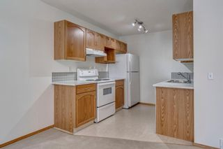 Photo 6: 40 Mt Aberdeen Manor SE in Calgary: McKenzie Lake Row/Townhouse for sale : MLS®# A1100285