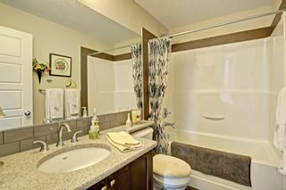 Photo 21: 82 Cranbrook Drive SE in Calgary: Cranston Row/Townhouse for sale : MLS®# A1075225