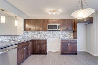 Photo 9: 162 AUBURN BAY Boulevard SE in Calgary: Auburn Bay Semi Detached for sale : MLS®# A1114634