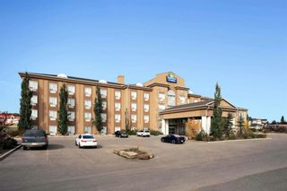 Photo 2: : Strathmore Hotel/Motel for sale : MLS®# A1040076