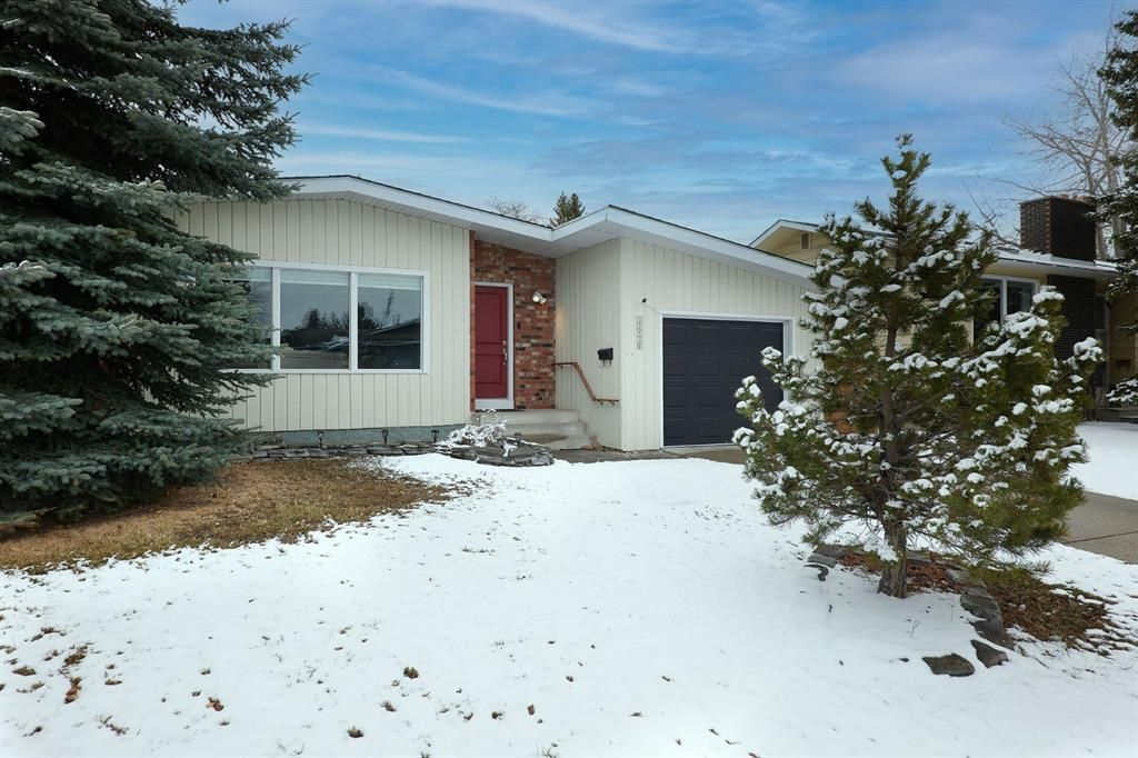 Main Photo: 12420 Lake Christina Road SE in Calgary: Lake Bonavista Detached for sale : MLS®# A1085247
