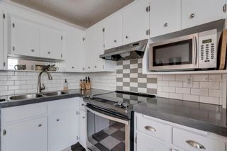 Photo 3: 5 127 11 Avenue NE in Calgary: Crescent Heights Row/Townhouse for sale : MLS®# A1063443