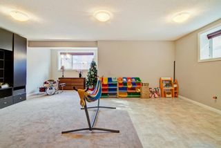 Photo 30: 28 Cougar Ridge Place SW in Calgary: Cougar Ridge Detached for sale : MLS®# A1154068