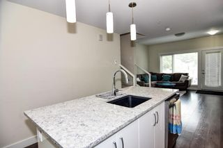 Photo 21: 207 20 Brentwood Common NW in Calgary: Brentwood Row/Townhouse for sale : MLS®# A1143237