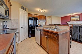 Photo 9: 784 LUXSTONE Landing SW: Airdrie House for sale : MLS®# C4160594