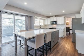 Photo 12: 884 Coach Side Crescent SW in Calgary: Coach Hill Detached for sale : MLS®# A1105957