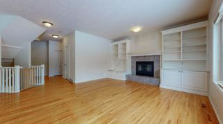 Photo 10: 48 Moreuil Court SW in Calgary: Garrison Woods Detached for sale : MLS®# A1075333