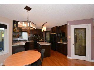 Photo 5: 148 GLENEAGLES Close: Cochrane House for sale : MLS®# C4010996
