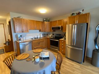 Photo 1: 304 5026 49 Street in Olds: Condo for sale : MLS®# A1098322