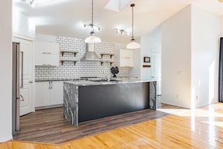 Photo 4: 48 West Springs Way SW in Calgary: West Springs Row/Townhouse for sale : MLS®# A1148807