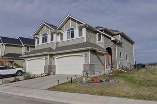 Photo 1: 8 St. Andrews Close: Lyalta Semi Detached for sale : MLS®# A1153055