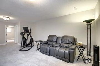 Photo 21: 374 Quarry Park Boulevard SE in Calgary: Douglasdale/Glen Row/Townhouse for sale : MLS®# A1063797