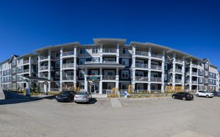 Main Photo: 411 200 Auburn Meadows Common SE in Calgary: Auburn Bay Apartment for sale : MLS®# A1095175