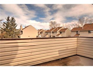 Photo 8: 248 54 GLAMIS Green SW in Calgary: Glamorgan House for sale : MLS®# C4109785