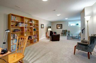 Photo 27: 340 Quarry Park Boulevard SE in Calgary: Douglasdale/Glen Row/Townhouse for sale : MLS®# A1123884