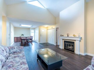 Photo 3: 404 2733 ATLIN PLACE in Coquitlam: Coquitlam East Condo for sale : MLS®# R2419896