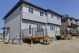 Photo 22: 136 Creekside Drive SW in Calgary: C-168 Semi Detached for sale : MLS®# A1108851