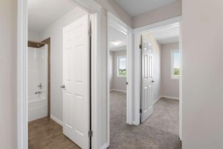 Photo 25: 407 620 Luxstone Landing SW: Airdrie Row/Townhouse for sale : MLS®# A1121530