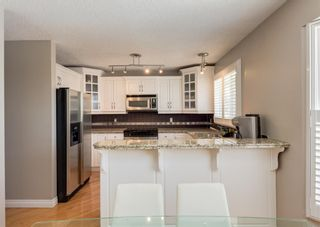 Photo 15: 848 Coach Side Crescent SW in Calgary: Coach Hill Detached for sale : MLS®# A1082611