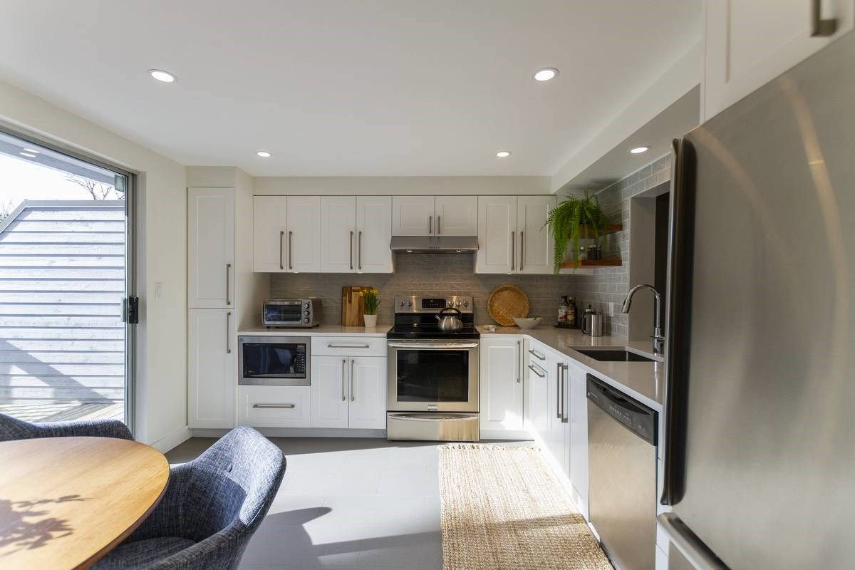 """Main Photo: 8165 FOREST GROVE Drive in Burnaby: Forest Hills BN Townhouse for sale in """"Wembley Estate"""" (Burnaby North)  : MLS®# R2551678"""