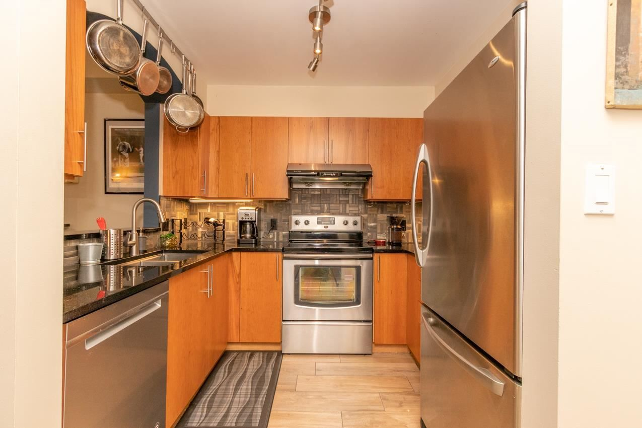 """Main Photo: 302 3600 WINDCREST Drive in North Vancouver: Roche Point Condo for sale in """"WINDSONG AT RAVEN WOODS"""" : MLS®# R2592930"""